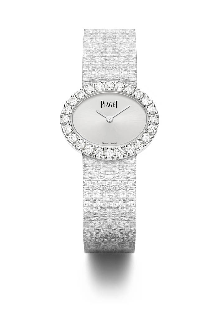 Montre traditionnelle ovale 27 x 22 mm, en or blanc 18k sertie de 24 diamants taille brillant
